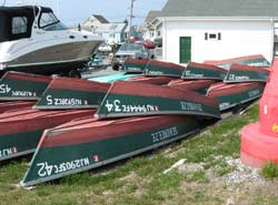 rental boats stacked along the shore of Barnegat Bay