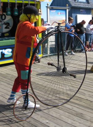 a clown with a bicycle