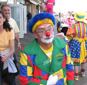 and more clowns walking on the boardwalk during clownfest