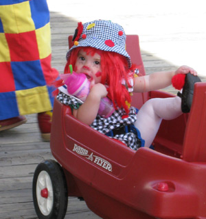 a young clown in a wagon
