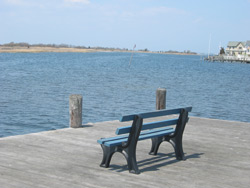 two empty benches along the shore of the bay